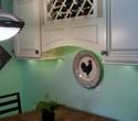 White LED under cabinet lighting under wine rack cabinetry